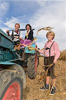 farm and boys - Family on tractor in cornfield, Bavaria, Germany Stock Photo - Premium Royalty-Freenull, Code: 6121-07739941