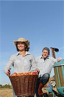 Farmer couple with tractor and basket of apples, Bavaria, Germany Stock Photo - Premium Royalty-Freenull, Code: 6121-07739959
