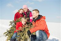 snow christmas tree white - Family sitting with branches in winter, smiling, Bavaria, Germany Stock Photo - Premium Royalty-Freenull, Code: 6121-07740028
