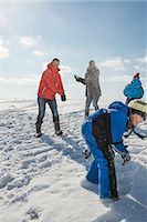 Family having snowball fight, smiling, Bavaria, Germany Stock Photo - Premium Royalty-Freenull, Code: 6121-07740069