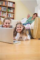 pantyhose kid - Granddaughters using laptop while grandparents in background Stock Photo - Premium Royalty-Freenull, Code: 6121-07740287