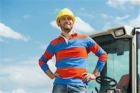Construction worker on site with excavator Stock Photo - Premium Royalty-Freenull, Code: 6121-07740299