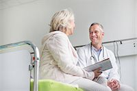 Doctor listening to patient Stock Photo - Premium Royalty-Freenull, Code: 6121-07740459