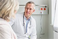 Doctor listening to patient Stock Photo - Premium Royalty-Freenull, Code: 6121-07740460