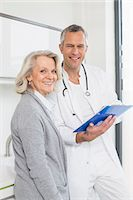 results - Doctor discussing treatment with patient Stock Photo - Premium Royalty-Freenull, Code: 6121-07740477