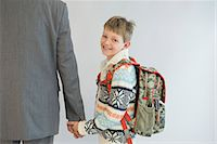Father accompanying his son to school, smiling Stock Photo - Premium Royalty-Freenull, Code: 6121-07740570