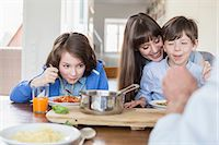 family table eating together - Family having meal Stock Photo - Premium Royalty-Freenull, Code: 6121-07740761