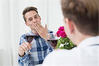 Homosexual couple with red wine Stock Photo - Premium Royalty-Freenull, Code: 6121-07740797