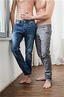 Homosexual couple standing on floor Stock Photo - Premium Royalty-Freenull, Code: 6121-07740805