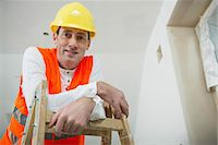 single mature people - Portrait of construction worker with safety helmet at construction site of new building Stock Photo - Premium Royalty-Freenull, Code: 6121-07741236