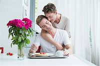 Homosexual couple having breakfast together, smiling Stock Photo - Premium Royalty-Freenull, Code: 6121-07741292