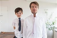 Portrait of father and son, smiling Stock Photo - Premium Royalty-Freenull, Code: 6121-07741382