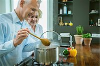 potted plant - Mature couple preparing food in kitchen, smiling Stock Photo - Premium Royalty-Freenull, Code: 6121-07741400