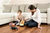 Mother and son playing with toys Stock Photo - Premium Royalty-Freenull, Code: 6121-07741455