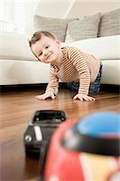 Portrait of boy playing with toys, smiling Stock Photo - Premium Royalty-Freenull, Code: 6121-07741456