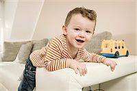 Portrait of boy playing with toys, smiling Stock Photo - Premium Royalty-Freenull, Code: 6121-07741457
