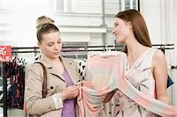 selecting - Sales girl with customer in fashion store Stock Photo - Premium Royalty-Freenull, Code: 6121-07741492
