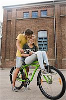 Teenage boy kissing teenage girl, smiling Stock Photo - Premium Royalty-Freenull, Code: 6121-07741523