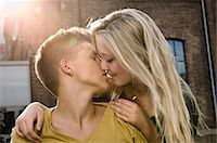 Teenage couple kissing each other, close up Stock Photo - Premium Royalty-Freenull, Code: 6121-07741603