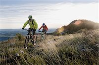 people mountain biking - two mountain bikers on the way downhill, Vipava valley, Istria, Slovenia Stock Photo - Premium Royalty-Freenull, Code: 6121-07741774