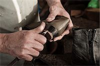Cobbler working in workshop, close-up Stock Photo - Premium Royalty-Freenull, Code: 6121-07741904