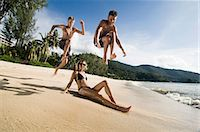 mother with two teenage sons at beach, Penang, Malaysia Stock Photo - Premium Royalty-Freenull, Code: 6121-07741946