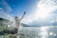 woman jumping into the ocean, Penang, Malaysia Stock Photo - Premium Royalty-Freenull, Code: 6121-07741947