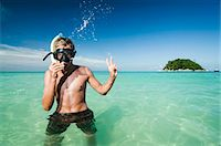 teenage boy with snorkeling equipment showing victory-sign, Koh Lipe, Thailand Stock Photo - Premium Royalty-Freenull, Code: 6121-07741957