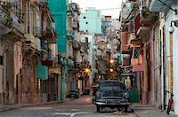 Street scene before sunrise showing dilapidated buildings crowded together and vintage American cars, Havana Centro, Havana, Cuba, West Indies, Caribbean, Central America Stock Photo - Premium Royalty-Freenull, Code: 6119-07744613