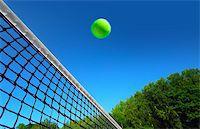 Tennis ball on net´s edge Stock Photo - Royalty-Freenull, Code: 400-07745613
