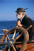 MATURE BEARDED MAN AT WHEEL OF SHIP Stock Photo - Premium Rights-Managednull, Code: 846-07760702