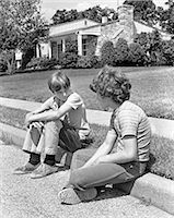 1970s TWO EARLY TEENAGE BOYS SITTING ON CURB SUBURBAN NEIGHBORHOOD TALKING Stock Photo - Premium Rights-Managednull, Code: 846-07760713