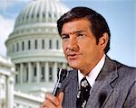 1960s 1970s MAN REPORTER NEWSMAN HOLDING MICROPHONE REPORTING FROM CAPITOL WASHINGTON DC USA