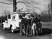release - 1940s GROUP OF BOYS CROWDING AROUND ICE CREAM MAN AT BACK OF GOOD HUMOR TRUCK Stock Photo - Premium Rights-Managednull, Code: 846-07760758