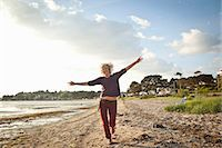 Mature woman enjoying beach Stock Photo - Premium Royalty-Freenull, Code: 649-07760820