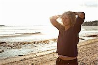 Mature woman enjoying beach Stock Photo - Premium Royalty-Freenull, Code: 649-07760821