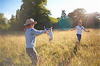 Group of young boys playing in a field Stock Photo - Premium Royalty-Freenull, Code: 649-07760866