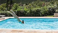 Young women diving into swimming pool, Capoterra, Sardinia, Italy Stock Photo - Premium Royalty-Freenull, Code: 649-07760959