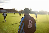 soccer player (male) - Rearview of football player number 8 Stock Photo - Premium Royalty-Freenull, Code: 649-07760986