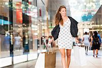 shopping mall - Mid adult woman walking with shopping bags Stock Photo - Premium Royalty-Freenull, Code: 649-07761051