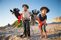 Two brothers dressed as cowboy's with hobby horse's Stock Photo - Premium Royalty-Freenull, Code: 649-07761109