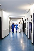 people hospital - Three medical professionals walking together down a corridor in a hospital Stock Photo - Premium Royalty-Freenull, Code: 653-07761277