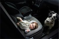 Baby girl and Portuguese Water Dog in car Stock Photo - Premium Royalty-Freenull, Code: 653-07761356
