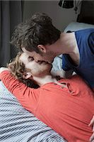 Young gay couple kissing in bedroom Stock Photo - Premium Royalty-Freenull, Code: 653-07761484