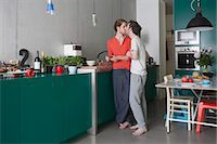 Full length of romantic gay couple kissing in kitchen Stock Photo - Premium Royalty-Freenull, Code: 653-07761491