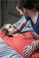 Romantic young gay couple looking at each other in bedroom Stock Photo - Premium Royalty-Freenull, Code: 653-07761517