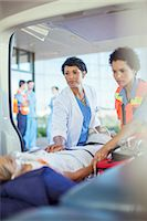 Doctor and paramedic examining patient in ambulance Stock Photo - Premium Royalty-Freenull, Code: 6113-07761995