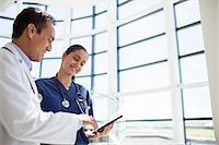 Doctor and nurse reading medical chart in hospital Stock Photo - Premium Royalty-Freenull, Code: 6113-07762022