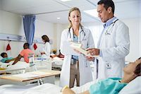 Doctors talking to patient in hospital room Stock Photo - Premium Royalty-Freenull, Code: 6113-07762076