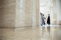 Lawyer and judge talking in hallway of courthouse Stock Photo - Premium Royalty-Freenull, Code: 6113-07762335
